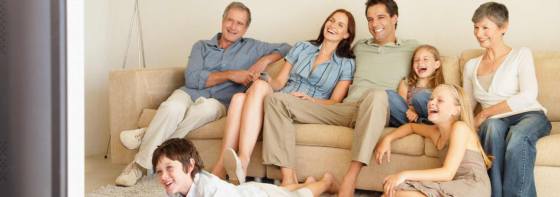 Family sat together watching the television